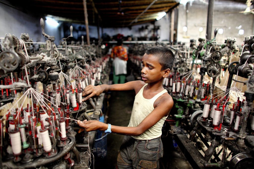 13 year old Sobuj works in a textile factory in conditions of extreme heat and noise. For this he earns about 1200 Taka a month (£10.00 GBP).