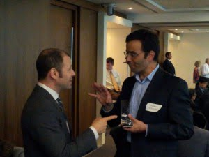 Volker Schaedler (VP Innovation BASF) and Nelson Switzer (Director of Sustainability Consulting PwC Canada) sharing ideas after the presentation.