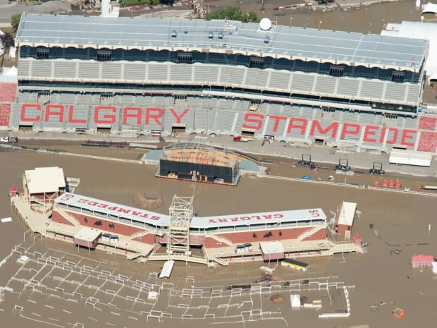 A flooded Calgary Stampede stadium is seen from a aerial view in Calgary, Ab. Saturday, June 22, 2013. (Jonathan Hayward/The Canadian Press)