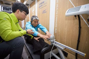 """Hyundai's """"energizing station"""" installs fitness equipment at gas stations and aboard a mobile bus to promote physical activity for taxi drivers. (Hyundai)"""