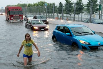 Toronto was hard-hit by flooding in July 2013. A poll commissioned by Public Safety Canada suggests many homeowners expect Ottawa will compensate them in the event of future flood disasters — but one expert says that may not be the case. (Frank Gunn/Canadian Press)