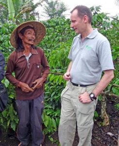 Rainforest Alliance President Nigel Sizer with a coffee farmer in Indonesia